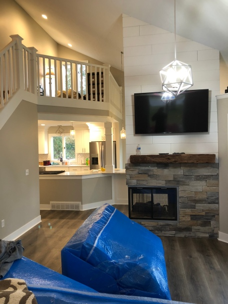 Shiplap and custom stone with gas fireplace